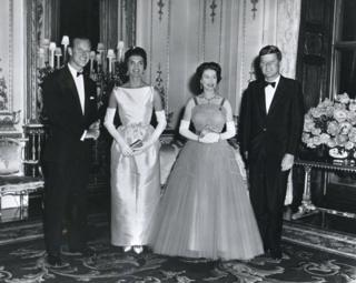 At Buckingham Palace during a banquet held in his honour, President John F Kennedy and his wife, First Lady Jacqueline Kennedy, pose with Queen Elizabeth II and her husband, Prince Philip, Duke of Edinburgh, London, United Kingdom, June 15, 1961.