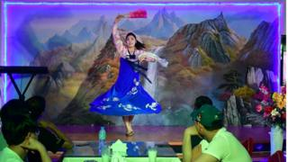 A traditional dancer performs for patrons at the Pyongyang Okryu-gwan, a North Korean restaurant in Dubai, 21 September 2017