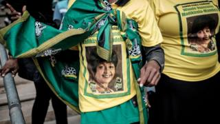 Mourners gather at the Olando Stadium in Soweto, outside Johannesburg, on April 11, 2018 during a memorial service for late South African anti-apartheid campaigner Winnie Madikizela-Mandela.