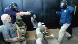 A firearm instructor teaching pilots in Artesia in October 2003