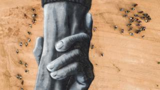 in_pictures Motorcyclists surround French artist Saype's Beyond Walls artwork of interlocking hands in Ouagadougou, Burkina Faso - Sunday 1 March 2020