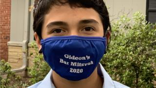 in_pictures Gideon wearing a mask that reads