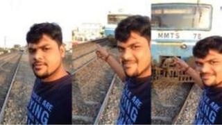 Mr T Siva, a lokacin da ya ke kokarin daukar kansa a hoton selfie