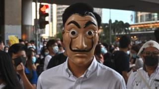A man wearing a cartoon mask takes part in a protest in the Central district in Hong Kong