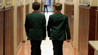 School boys in a corridor