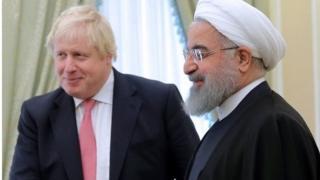 بوريس جونسون والرئيس الإيراني حسن روحاني