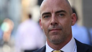 Dan Evans arrives at court