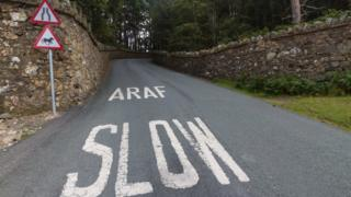 Bilingual road marking: Slow
