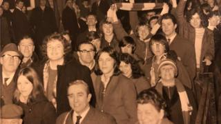 A crowd of Boro fans including a young Ali