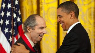 Philip Roth smiling while receiving the National Humanities Medal from then President Barack Obama in 2011