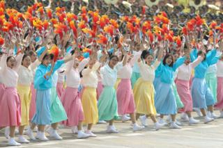 Performers walk and dance during the parade for the 70th anniversary of the establishment of the People's Republic of China, 1 October 2019 in Tiananmen Square.