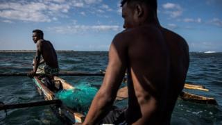 Fishermen on a boat.