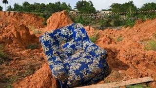 An armchair among rubbles at the site of a landslide that killed 13 people the day before, in Anyama, near Abidjan - 19 June 2020