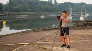 Adam Bennett photographing the sunrise in South Woodham Ferrers