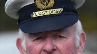 A mock customs officers stop cars at the border crossing between the Republic of Ireland and Northern Ireland