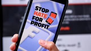 A smartphone showing the website of campaign group Stop Hate For Profit