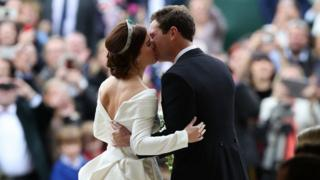 "Princess Eugenie and her new husband Jack Brooksbank kiss as they leave St George""s Chapel in Windsor Castle following tehir wedding"