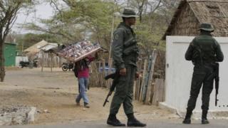 Venezuelan soldiers patrol the Colombian border
