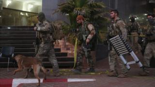 French soldiers leave the Radisson Blu hotel in Bamako after ending siege, where Islamist gunmen took hostages