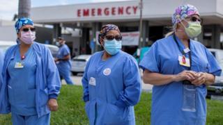 Healthcare workers hold a rally outside their hospital in California for safer working conditions during the coronavirus outbreak