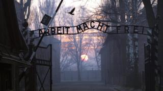 The gates of Auschwitz bearing the words 'Work sets you free'