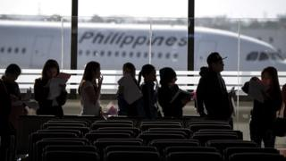 In this file photo taken on February 18, 2018 Filipina workers returning home from Kuwait arrive at Manila International Airport.