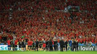 Fans applaud the Wales team after the game ends