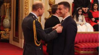 Prince William presenting Sam Warburton with his OBE at Buckingham Palace