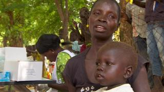 Two year old Taban and his mother after receiving treatment at the open air clinic in Juba