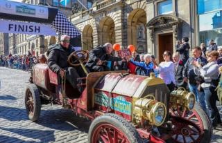 The first car home at the end of the Flying Scotsman car rally on a glorious afternoon on the high street in Edinburgh on Sunday.