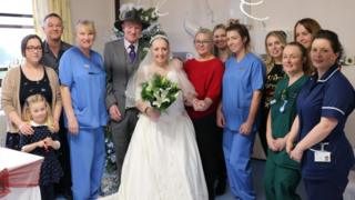 Hospital staff with married couple