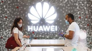 Technology People shop at a Huawei store in Barcelona, Spain