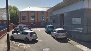 Cars parked outside Wrexham Shopmobility