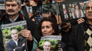 "Protesters hold poster portraits of Cumhuriyet""s chairman Akin Atalayas they attend a demonstration at the courthouse in Istanbul on March 15, 2018."
