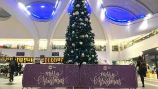 A Christmas tree within Birmingham New Street station