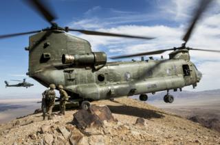 A Royal Air Force Chinook, from RAF Odiham, drops troops from 40 Commando Royal Marines onto a mountain peak in the Mojave desert during Exercise Black Alligator