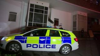 Investigations continue into the death of a man in a fire at a block of flats