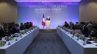 French Minister of Foreign Affairs Jean-Marc Ayrault addresses delegates at the opening of the Mideast peace conference in Paris, on 15 January 2017.