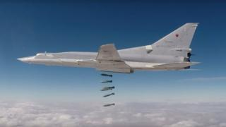 A still image from video handout shows a Russian long-range bomber hitting Islamic State targets in eastern Syria on 26 November