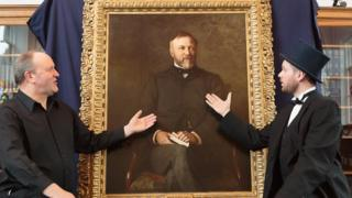Ian Hammond Brown and Joe Whiteman with a portrait of Andrew Carnegie