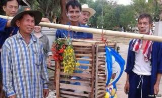 Villagers with the wooden cage with the toy inside