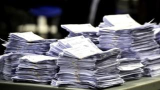 Ballot papers stacked up