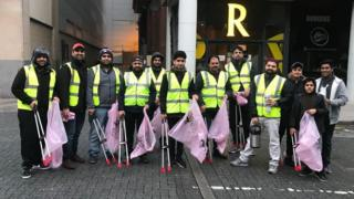 Group of Ahmadi Muslims picking up litter in Cardiff