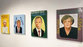 Four portraits of world leaders on the wall of art gallery
