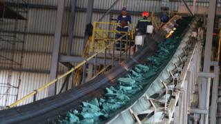 A conveyor belt carries chunks of raw cobalt after initial processing at a plant in Lubumbashi, Democratic Republic of Congo, before being exported to be refined.