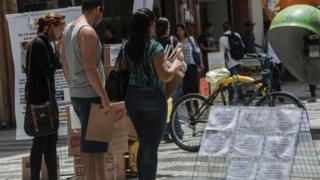 Brazilians reading job notices