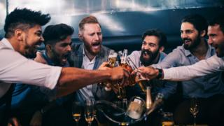 Stock photo of men drinking