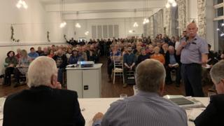 People at public meeting