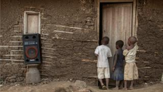 A group of children stand at the door of a makeshift cinema in Bugara on - Sunday 17 July 2016