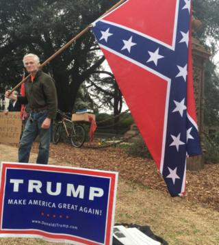 Confederate flag holder with Trump sign